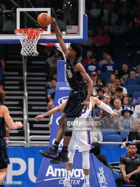 Jonathan Isaac of the Orlando Magic goes up for a dunk during the game against the Philadelphia 76ers at the Amway Center on March 25 2019 in Orlando...