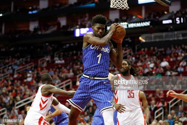 Jonathan Isaac of the Orlando Magic grabs a rebound in the first half against the Houston Rockets at Toyota Center on January 27 2019 in Houston...