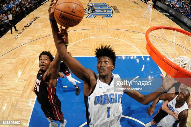 Jonathan Isaac of the Orlando Magic grabs the rebound against the Miami Heat during a preseason game on October 8 2017 at Amway Center in Orlando...