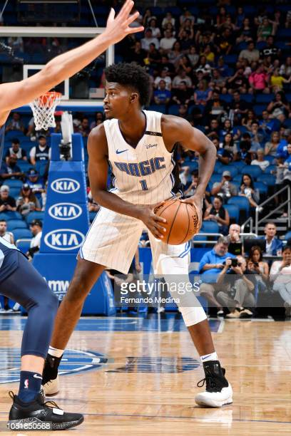 Jonathan Isaac of the Orlando Magic handles the ball against the Memphis Grizzlies during a preseason game on October 10 2018 at Amway Center in...