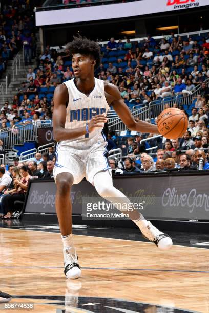 Jonathan Isaac of the Orlando Magic handles the ball against the Miami Heat during a preseason game on October 8 2017 at Amway Center in Orlando...