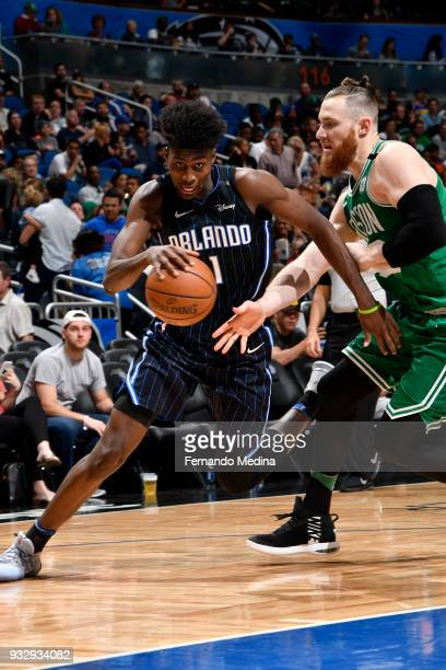 Jonathan Isaac of the Orlando Magic handles the ball against the Boston Celtics on March 16 2018 at Amway Center in Orlando Florida NOTE TO USER User...