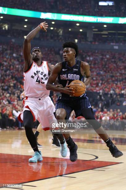 Jonathan Isaac of the Orlando Magic handles the ball against the Toronto Raptors during Game One of Round One of the 2019 NBA Playoffs on April 13...