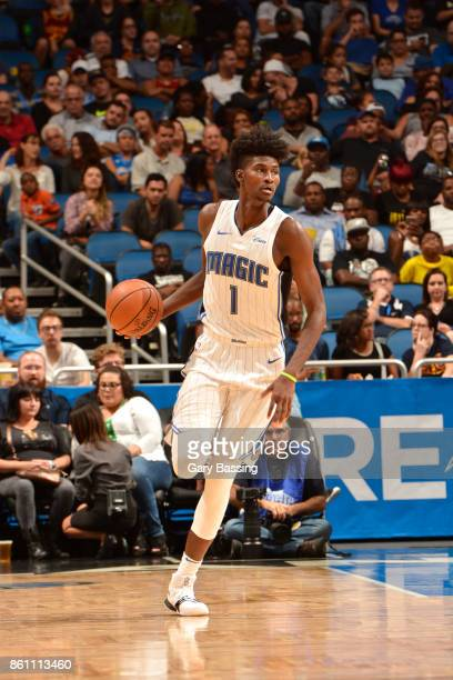 Jonathan Isaac of the Orlando Magic handles the ball against the Cleveland Cavaliers during the preseason game on October 13 2017 at Amway Center in...