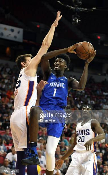 Jonathan Isaac of the Orlando Magic is fouled as he drives against Dragan Bender of the Phoenix Suns during the 2018 NBA Summer League at the Thomas...