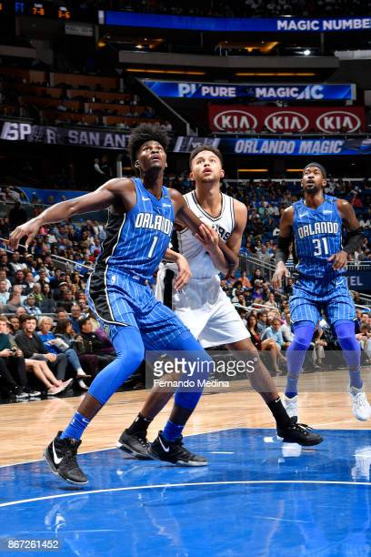 Jonathan Isaac of the Orlando Magic Kyle Anderson of the San Antonio Spurs and Terrence Ross of the Orlando Magic await the ball during the game on...