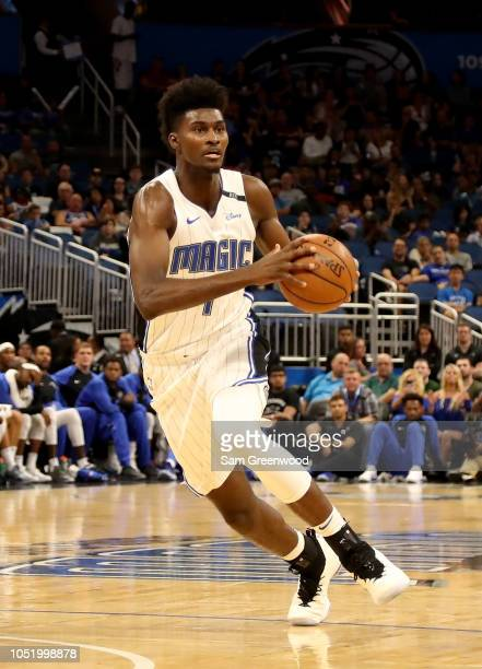 Jonathan Isaac of the Orlando Magic looks to make a pass during a preseason game against the San Antonio Spurs at Amway Center on October 12 2018 in...