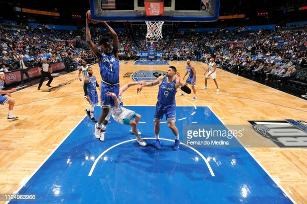 Jonathan Isaac of the Orlando Magic rebounds the ball against the Charlotte Hornets on February 14 2019 at Amway Center in Orlando Florida NOTE TO...