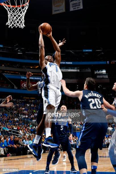 Jonathan Isaac of the Orlando Magic rebounds the ball during the game against the Dallas Mavericks on April 4 2018 at Amway Center in Orlando Florida...