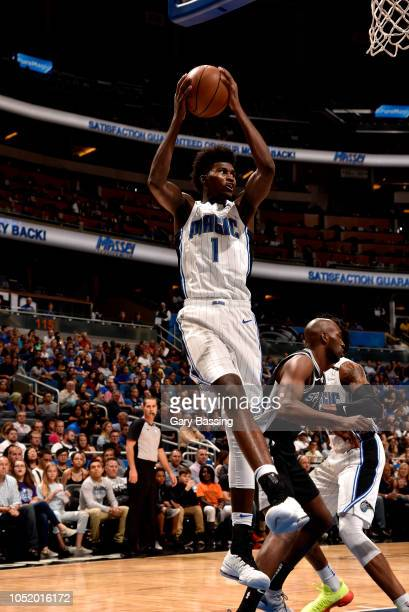 Jonathan Isaac of the Orlando Magic shoots the ball against the San Antonio Spurs during a preseason game on October 12 2018 at the Amway Center in...