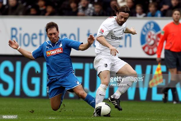Jonathan Jaeger of Freiburg is challenged by Tobias Weis of Hoffenheim during the Bundesliga match between 1899 Hoffenheim and SC Freiburg at the...