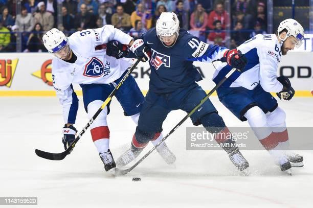 Jonathan Janil of France tackles Luke Glendening of USA during the 2019 IIHF Ice Hockey World Championship Slovakia group A game between United...