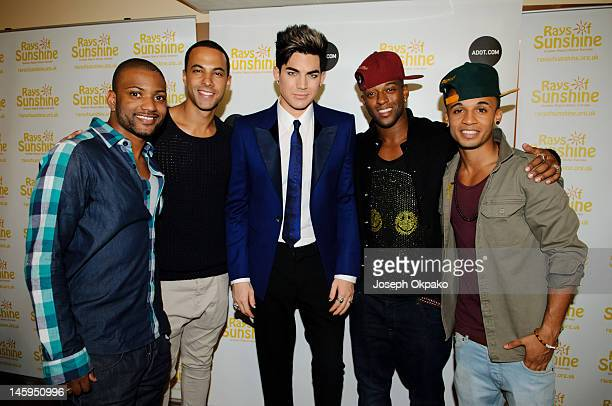 Jonathan 'JB' Gill Marvin Humes Adam Lambert Oritse Williams and Aston Merrygold poses for a picture backstage before performing on stage at the Rays...