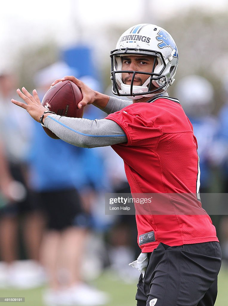 Jonathan Jennings #4 of the Detroit Lions drops back to pass during Detroit Lions Rookie Minicamp on May 16, 2014 in Allen Park, Michigan.