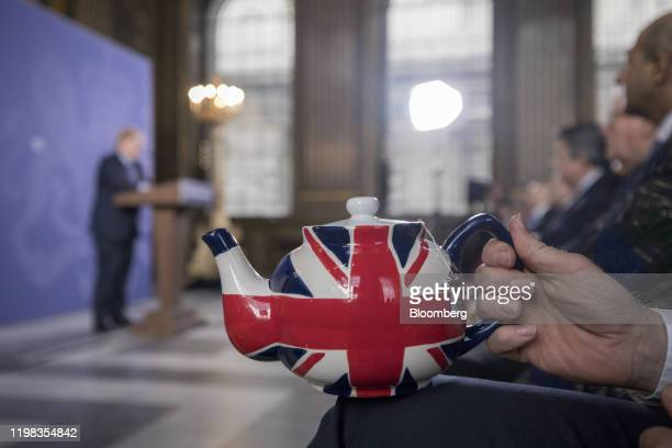 Jonathan Jones managing director of trading at Tregothnan sits holding a teapot featuring the design of a British Union flag also known as a Union...