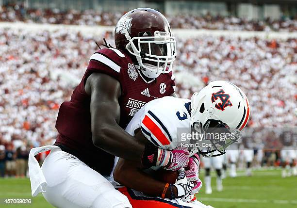 Jonathan Jones of the Auburn Tigers intercepts a touchdown reception intended for De'Runnya Wilson of the Mississippi State Bulldogs at Davis Wade...