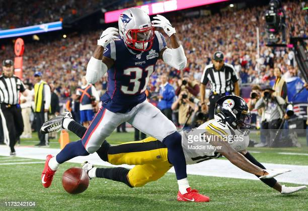 Jonathan Jones of the New England Patriots defends a pass intended for Diontae Johnson of the Pittsburgh Steelers during the second half at Gillette...