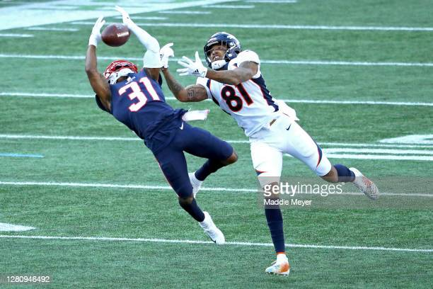 Jonathan Jones of the New England Patriots intercepts a ball intended for Tim Patrick of the Denver Broncos during the second half at Gillette...