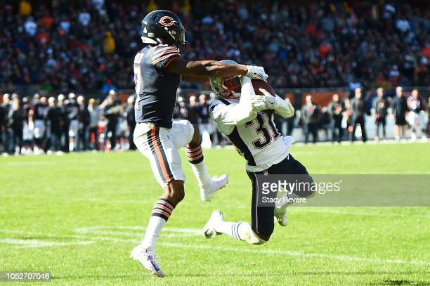 Jonathan Jones of the New England Patriots intercepts a pass intended for Anthony Miller of the Chicago Bears in the fourth quarter at Soldier Field...