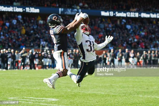 Jonathan Jones of the New England Patriots intercepts a pass intended for Anthony Miller of the Chicago Bears during a game at Soldier Field on...