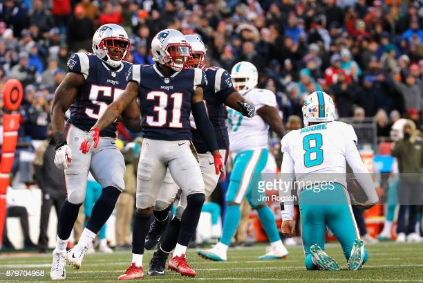 Jonathan Jones of the New England Patriots reacts after sacking Matt Moore of the Miami Dolphins during the fourth quarter of a game at Gillette...