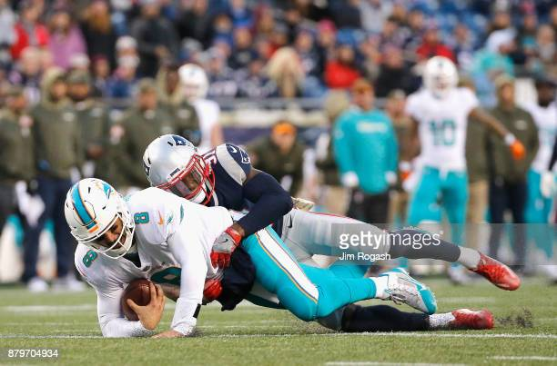 Jonathan Jones of the New England Patriots sacks Matt Moore of the Miami Dolphins during the fourth quarter of a game at Gillette Stadium on November...