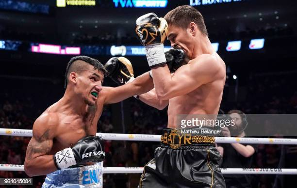 Jonathan Jose Entz of Argentina punches Batyr Jukembayev of Canada during their Super Lightweight fight at the Videotron Center on May 26 2018 in...