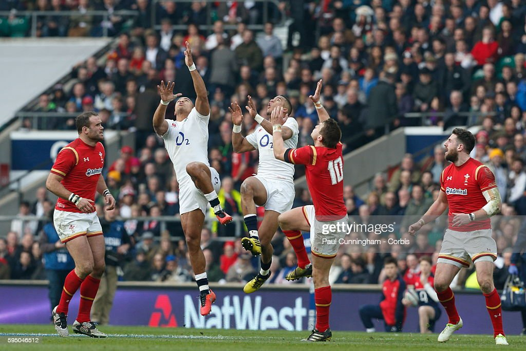 Jonathan Joseph, Anthony Watson and Dan Biggar all tale to the air for the high ball during the RBS 6 Nations match between England v Wales at Twickenham Stadium. London, England. 12 March 2016 --- Image by © Paul Cunningham/Corbis