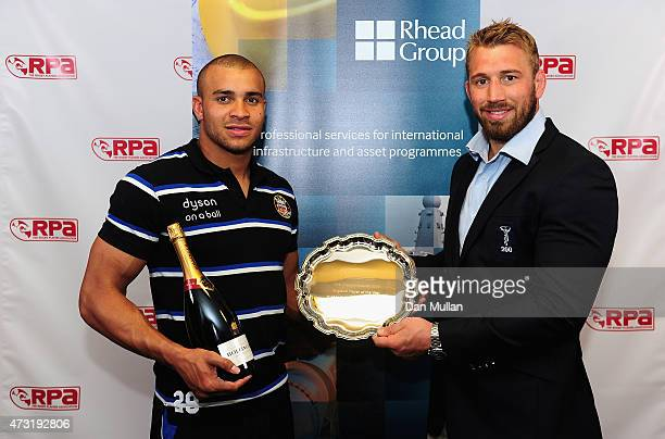 Jonathan Joseph of Bath and England receives the Rhead Group England Player of the Year award from England Captain Chris Robshaw of Harlequins...