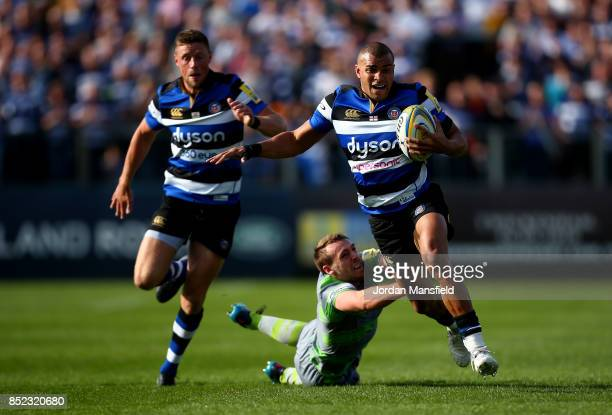 Jonathan Joseph of Bath avoids a tackle from Chris Harris of Newcastle during the Aviva Premiership match between Bath Rugby and Newcastle Falcons at...