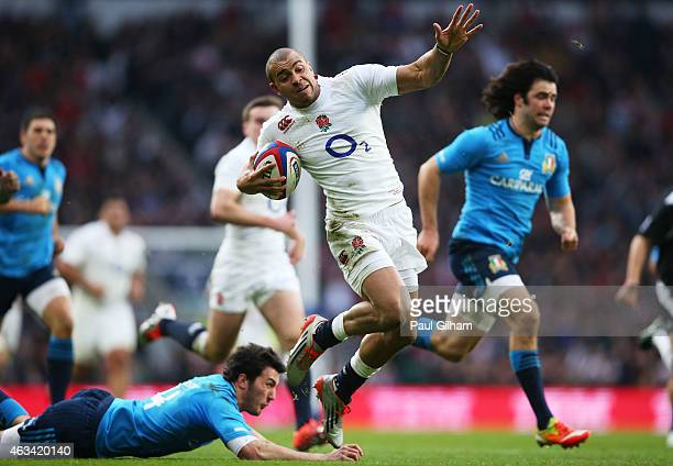 Jonathan Joseph of England breaks clear to score his team's second try during the RBS Six Nations match between England and Italy at Twickenham...