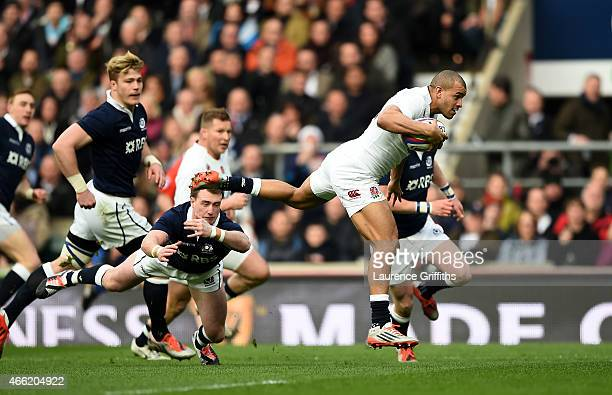 Jonathan Joseph of England breaks through the tackle from Stuart Hogg of Scotland to score the opening try during the RBS Six Nations match between...
