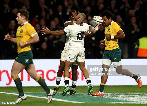 Jonathan Joseph of England celebrates scoring his sides fourth try with Marland Yarde of England during the Old Mutual Wealth Series match between...