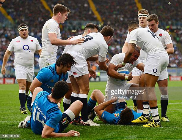 Jonathan Joseph of England is congratulated by teammates after scoring his team's fourth try and completing his hat trickduring the RBS Six Nations...