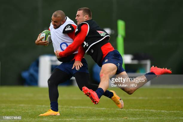 Jonathan Joseph of England is tackled by Ben Earl of England during a training session at The Lensbury on November 11, 2020 in Teddington, England.