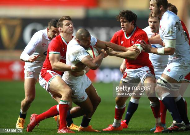 Jonathan Joseph of England is tackled by Dan Biggar during the Quilter International match between Wales and England as part of the Autumn Nations...