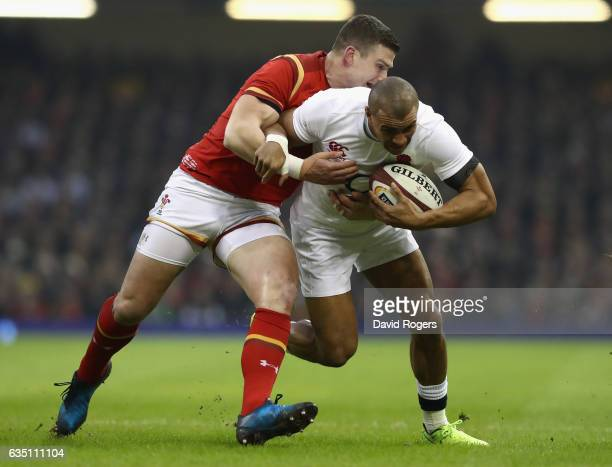 Jonathan Joseph of England is tackled by Scott Williams during the RBS Six Nations match between Wales and England at the Principality Stadium on...