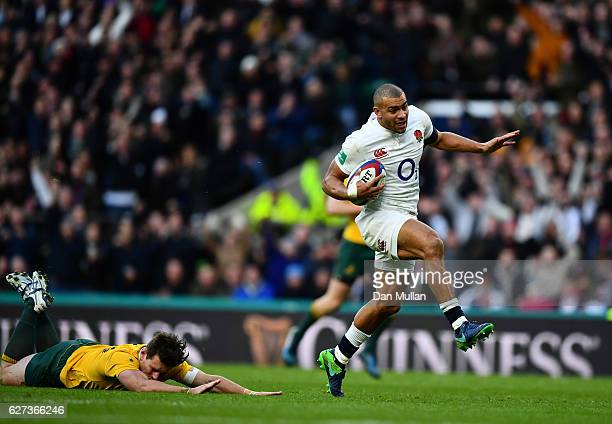 Jonathan Joseph of England scores his sides first try while Bernard Foley of Australia attempts to tackle him during the Old Mutual Wealth Series...