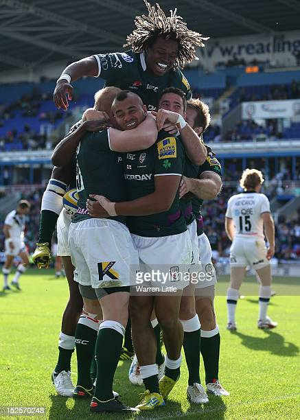 Jonathan Joseph of London Irish is congratulated by team mates after scoring a try during the Aviva Premiership match between London Irish and Bath...