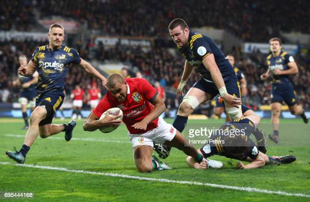 Jonathan Joseph of the Lions dives over to score his team's first try during the 2017 British Irish Lions tour match between the Highlanders and the...