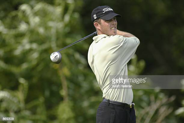 Jonathan Kaye hits a shot during Sunday's final round of the Canon Greater Hartford Open on June 23 2002 at TPC River Highlands in Cromwell...