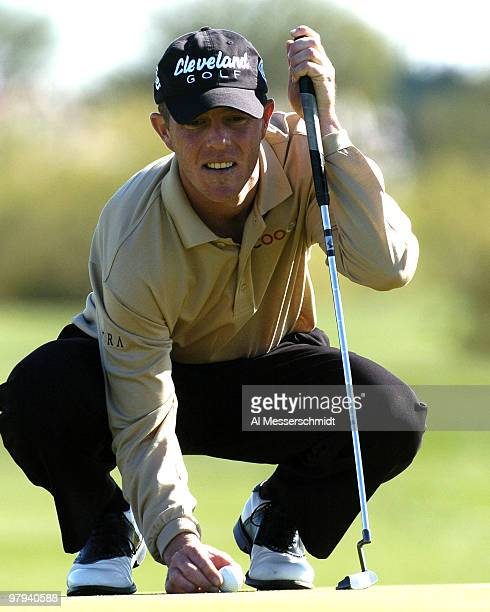 Jonathan Kaye lines up a putt during final round competition February 1 2004 at the 2004 FBR Open at the Tournament Players Club at Scottsdale...