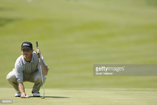 Jonathan Kaye looks over a putt during Friday's second round of the Canon Greater Hartford Open on June 21 2002 at TPC River Highlands in Cromwell...
