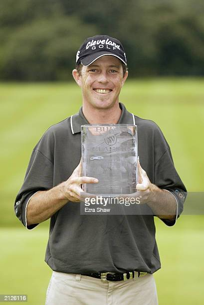 Jonathan Kaye with the trophy after winning the Buick Classic on June 22 2003 at the Westchester Country Club in Harrison New York