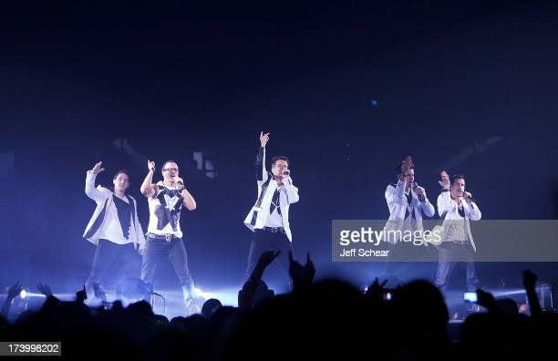 Jonathan Knight Donnie Wahlberg Joey McIntyre Jordan Knight and Danny Wood of New Kids On The Block perform at Allstate Arena on July 18 2013 in...