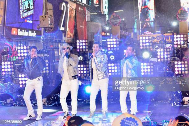 Jonathan Knight Donnie Wahlberg Jordan Knight and Danny Wood of New Kids on the Block perform on stage during Dick Clark's New Year's Rockin' Eve...