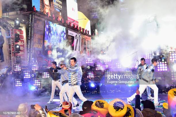 Jonathan Knight Donnie Wahlberg Jordan Knight Danny Wood and Joey McIntyre of New Kids on the Block perform on stage during Dick Clark's New Year's...