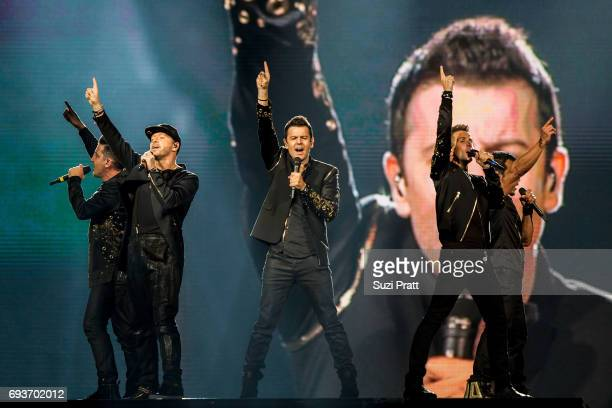Jonathan Knight Donnie Wahlberg Jordan Knight Joey McIntyre and Danny Wood of New Kids on the Block perform during 'The Total Package Tour' at...