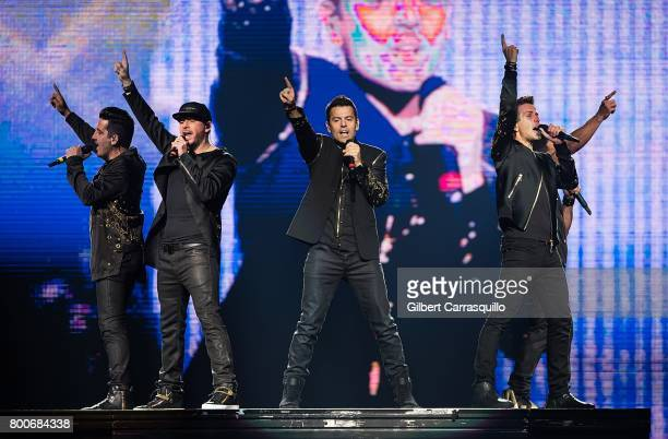 Jonathan Knight Donnie Wahlberg Jordan Knight Joey McIntyre and Danny Wood of New Kids On The Block perform during 'The Total Package Tour' at Wells...