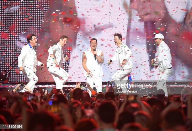 Jonathan Knight Joey McIntyre Danny Wood Jordan Knight and Donnie Wahlberg of the musical group New Kids On The Block perform at Bridgestone Arena on...